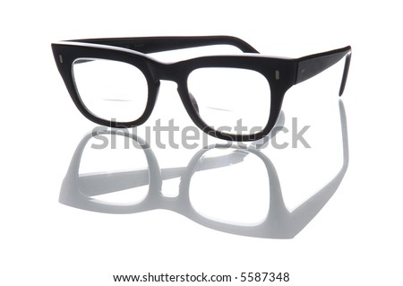 Old geeky style bifocal spectacles. - stock photo