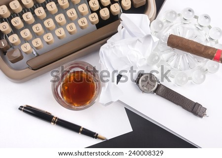 Old german type writer with paper, cigare, vintage watch, fountain pen and glass of whiskey - stock photo