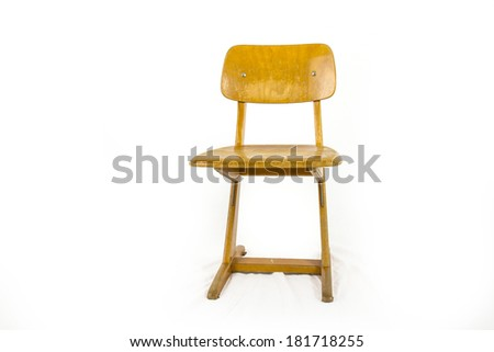 old german used wooden school chair for the young pupils - stock photo