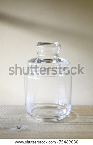 Old glass bottle on a wooden table - stock photo