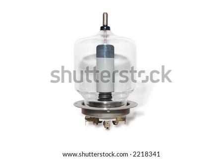 Old glass radio transmitting valve on its metallic socket, isolated on white background - stock photo