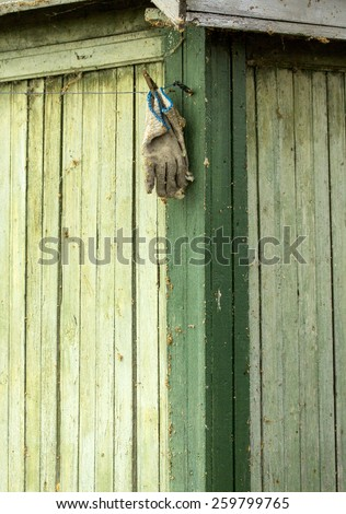 old glove on wooden background - stock photo