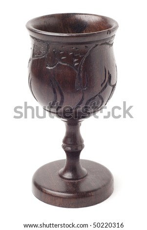 Old goblet made of dark wood from South-West Africa. Studio shot, isolated on white background. Saved with clipping path