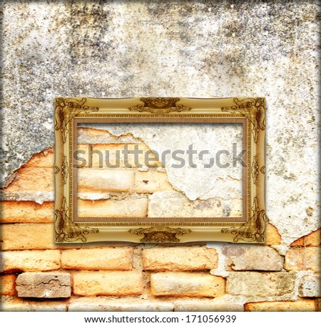 old gold antique picture frame on the old brick wall background - stock photo