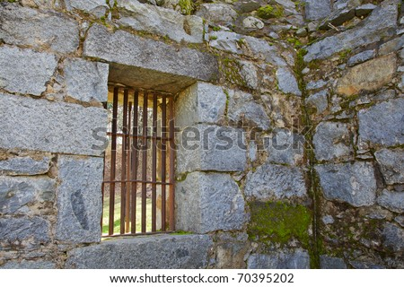 Old gold country jail cell steel barred windows - stock photo