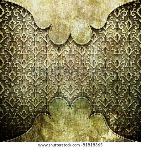 Old gold ornament on wooden wall - stock photo