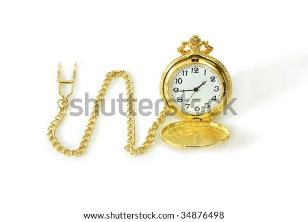 Old gold watch over white