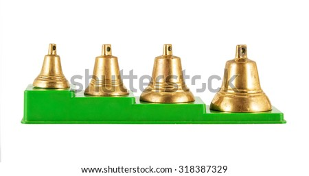 old golden bells isolated on a white background - stock photo