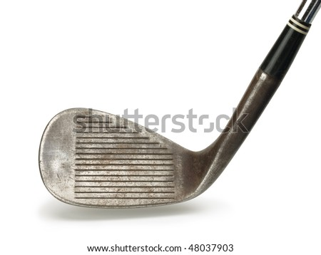 Old golf club. head section of a old forged raw iron wedge, with natural shadow. - stock photo