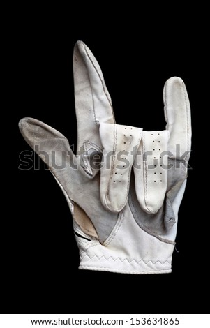 old golf glove in black back ground - stock photo