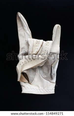 old  golf glove in black background