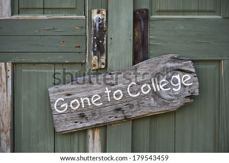 Old gone to college sign on doorway. - stock photo