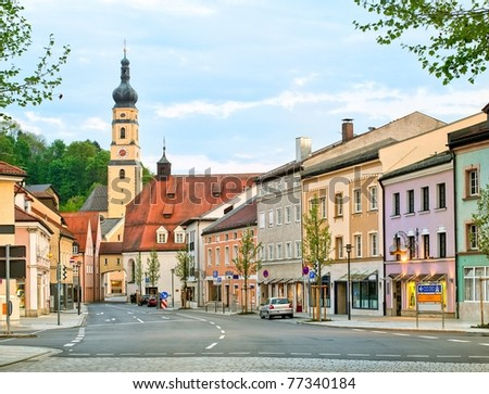 Old gothic house and church in the center of a german town - stock photo