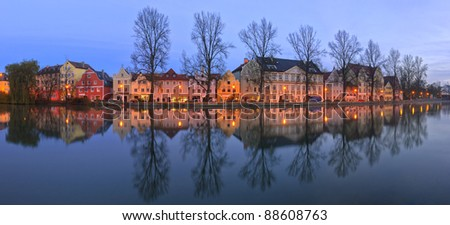 Old gothic houses reflected in Danube river in Germany