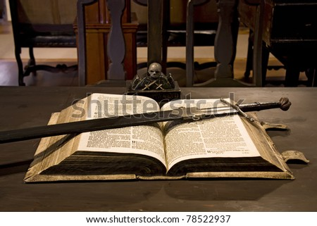 Old Gothic interior with manuscript and sword. - stock photo