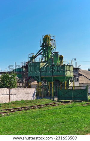 Old grain elevator (storage) with a railway track - stock photo