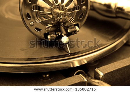 Old gramophone and old records - stock photo