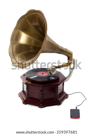 Old gramophone and smart phone - stock photo