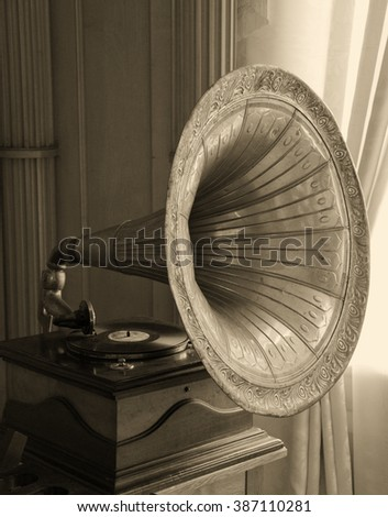 Old gramophone horn (in sepia, vintage style) - stock photo