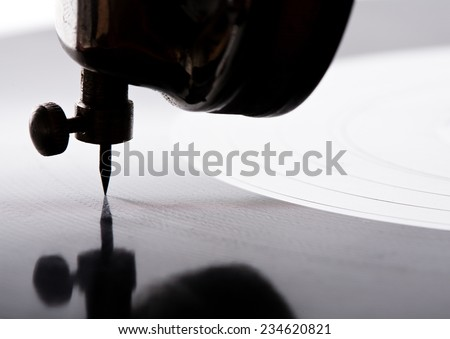 old gramophone needle closeup playing vinyl record - stock photo