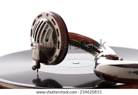 old gramophone pickup closeup playing vinyl record - stock photo