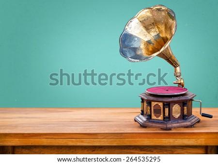Old gramophone ,retro radio receiver vintage green background - stock photo