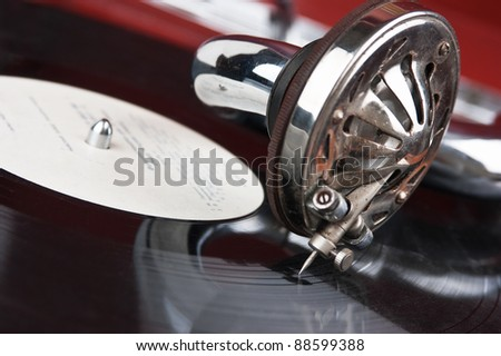 Old gramophone with a vinyl - stock photo