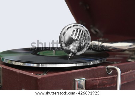 Old gramophone with a wooden body and a spring drive - stock photo