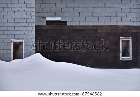 Old Granary and barn in winter Saskatchewan Canada - stock photo