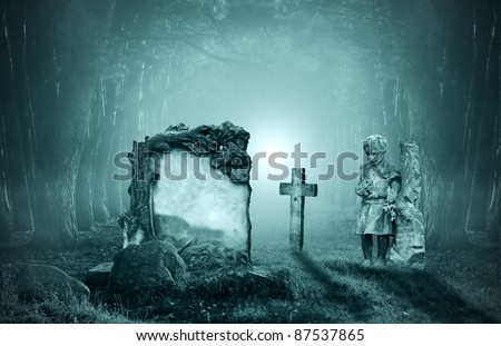 Old graves in a forest at night - stock photo