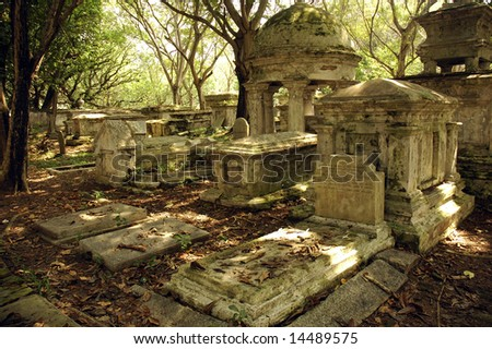 Old gravestone at cemetery - stock photo