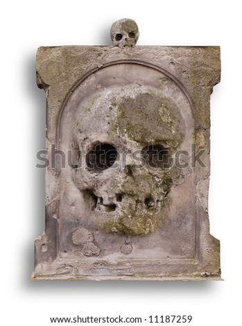 Old gravestone with a stone skull - stock photo