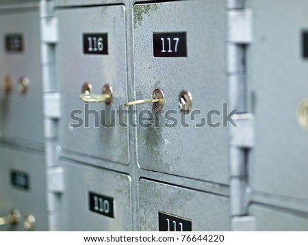 Old Gray and Numbered Safety Deposit Boxes - stock photo