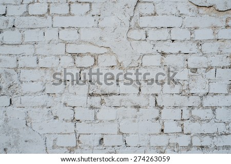 Old gray brick wall. - stock photo