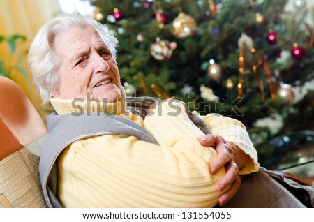 old gray-haired woman with hand pain - stock photo
