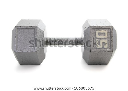 Old, gray, hexagonal shaped dumbbell hand weight. - stock photo