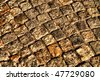 Old gray medieval weathered cobblestone way - stock photo