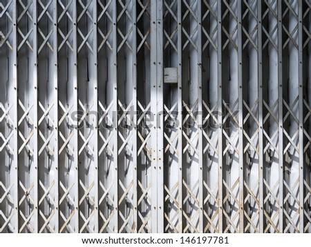 Old gray sliding metal door in Thailand - stock photo