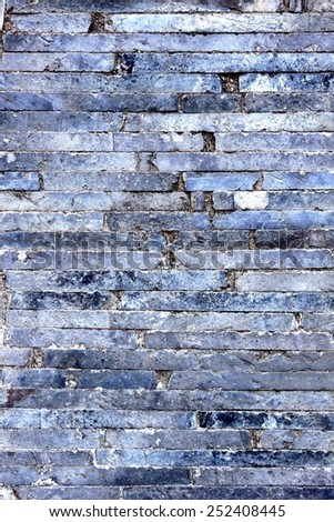 Old gray small shelf clinker walkway. - stock photo