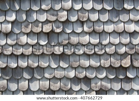 old gray wood shingles on a wall - stock photo