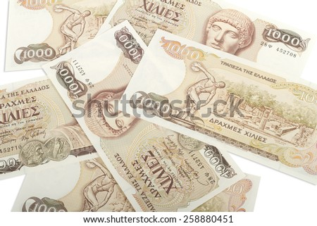 Old Greek currency of 1000 drachmas bills isolated on white. - stock photo