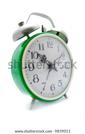 Old green alarm clock on a white background