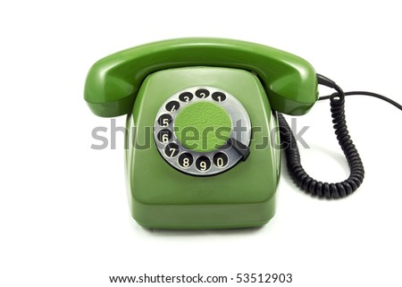Old green analogue  phone on a white background - stock photo
