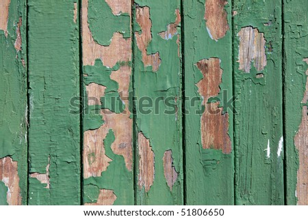 Old green boards in the cracked paint - stock photo