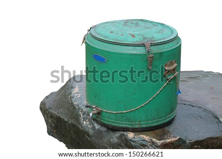 Old green bucket and wet stone isolated on white background