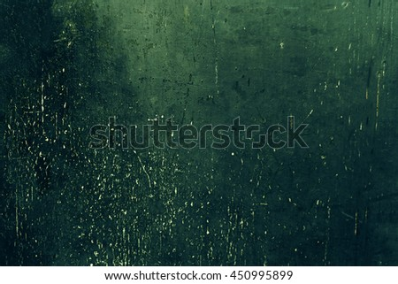 Old green colored Grunge background / Dark textured wall closeup