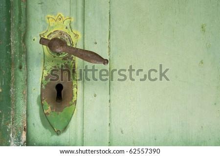Old Green Door Handle and Lock - stock photo