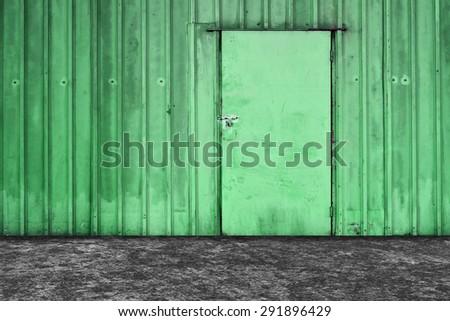 Old green metal door background. - stock photo