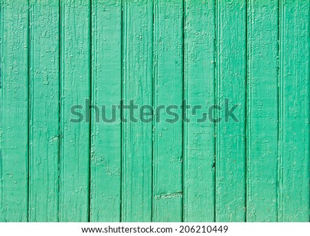 Old green painted wooden plank background. Close up - stock photo