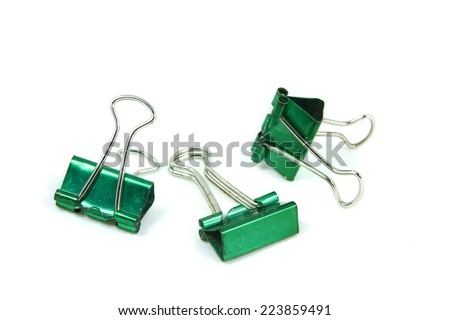 Old Green Paper clip isolated on white background.; The paper binder clip used for paper and documents. It can use for  background and other up to your decoration.